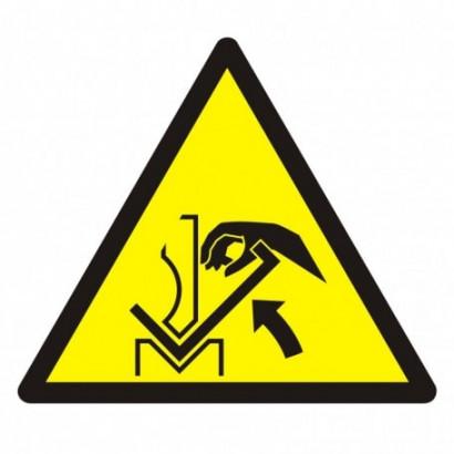 Ostrzeżenie przed zgnieceniem dłoni między prasą i materiałem