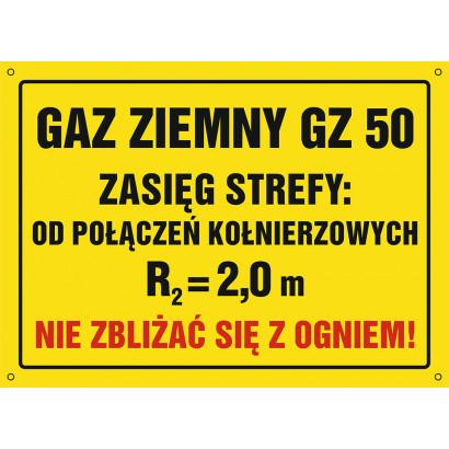 Znak - Gaz ziemny GZ-50. Zasięg strefy od połączeń kołnierzowych. Nie zbliżać się z ogniem NB034